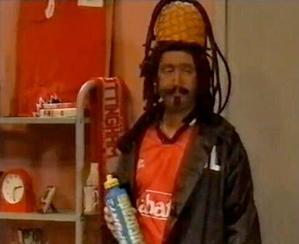 Still of David Baddiel in blackface from a 90s TV sketch.